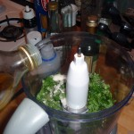 Adding Olive Oil to the Sugar and Mint in the Food Processor