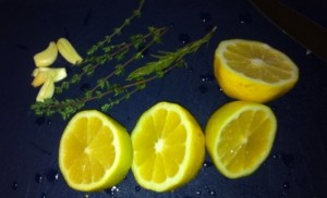 Lemon, Garlic Cloves and Thyme Sprigs