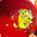 Whisking egg, parsley and cheese